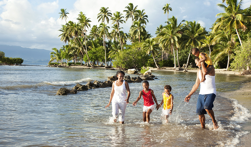Family enjoying a worry-free winter vacation on a tropical beach.